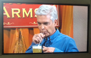 Phillip drinking a beer cocktail (snapped from my TV BTW!)